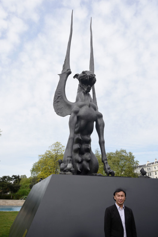 LONDON, ENGLAND - MAY 11:  Artist Dashi Namdakov stands in front of his  monumental bronze sculpture 'She Guardian' at its unveiled by Halcyon Gallery in Marble Arch on May 11, 2015 in London, England. The sculpture is 11 metres high and took the artist over two years to complete, and looks out over London with her protective maternal instict.  (Photo by Mary Turner/Getty Images for Halcyon Gallery)