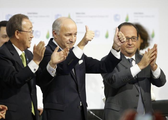 French President Francois Hollande and UN Secretary-General Ban Ki-moon react during the final plenary session at the World Climate Change Conference 2015 (COP21) at Le Bourget