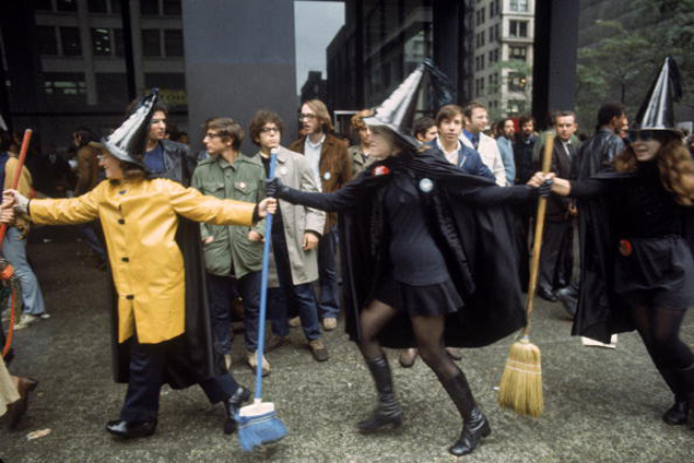 Yippie protesters dressed like witches outside the